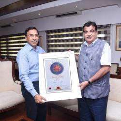Gopal Krishna,Secretary(Shipping) presenting the Skoch Award to the Hon'ble Minister for Shipping,Sh.Nitin Gadkari
