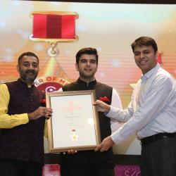 Sh. Abhishek Chandra, Deputy Secreatry (Sagarmala) receiveing the 'Order of Merit' for Sagarmala Programme